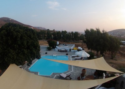 Aerial view swimming pool Cycladic apartment
